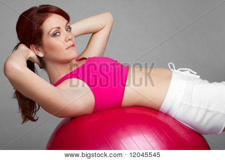 Situps woman using exercising ball
