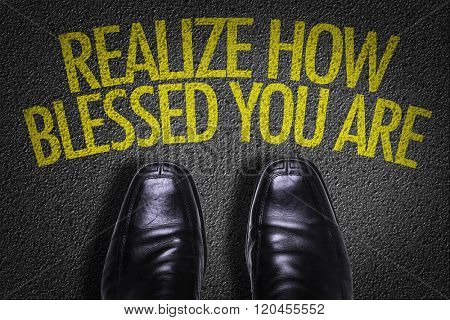 Top View of Business Shoes on the floor with the text: Realize How Blessed You Are