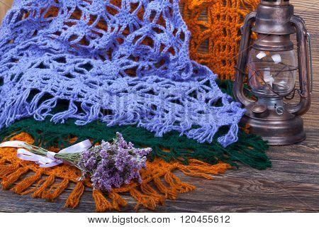 Knitted Woolen Female Shawls On Wooden Background