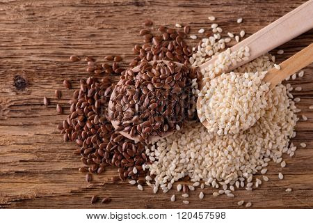 Sesame Seeds And Flax Seeds On Wooden Spoons