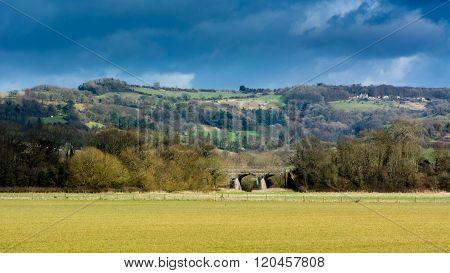 View Of Railway Bridge In English Countryside