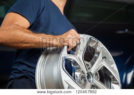 Technician Holding Alloy