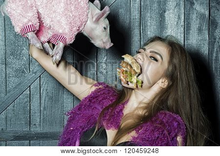 Girl With Burger And Pig