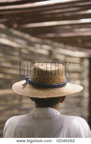 Rear view portrait of man wearing straw hat