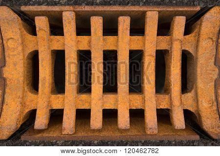 Rusty grid of a storm drain