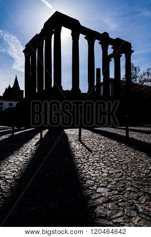 Evora, Portugal. Silhouette of the iconic Roman Temple dedicated to the Emperor cult, also wrongly considered as a Goddess Diana Temple. UNESCO World Heritage Site.