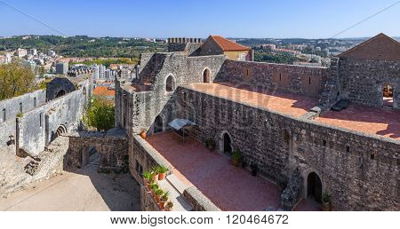 The Palatial Residence (Pacos Novos) on the right, and the ruins of the Nossa Senhora da Pena church on the left at the Leiria Caste. Leiria, Portugal.