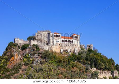 The Leiria Castle built on top of a hill with a view over the gothic Palatial Residence area (Pacos Novos). Leiria, Portugal.