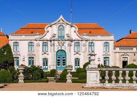 Queluz, Portugal. Neptune gardens (baroque) and one of the facades of the Queluz Royal Palace (Portugal). Formerly used as the Summer residence by the Portuguese royal family.