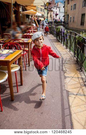 Sweet Portrait Of Preschool Boy In The Town Of Annecy, France, Springtime