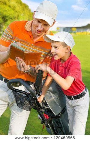 Father with son at golf
