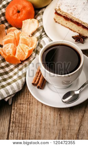 Breakfast with cup coffee and tangerine rustic style on wooden board