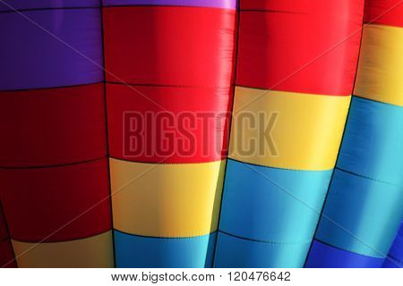 a close up of a very colorful hot air balloon with square color patterns