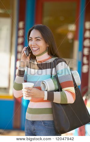 Hispanic woman on cell phone outdoors