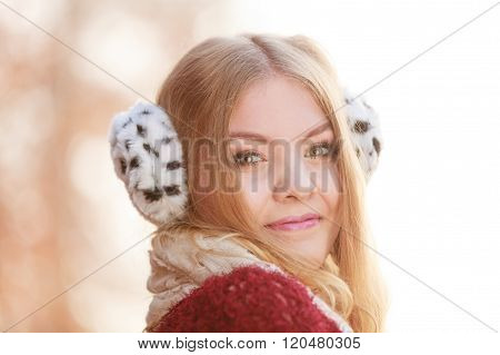 Portrait Of Pretty Smiling Woman In Fur Earmuffs.
