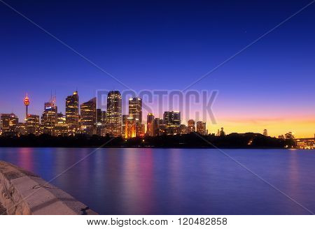 Australia Sydney city CBD view from cremorne point over harbour waters at sunset, taken by long expo