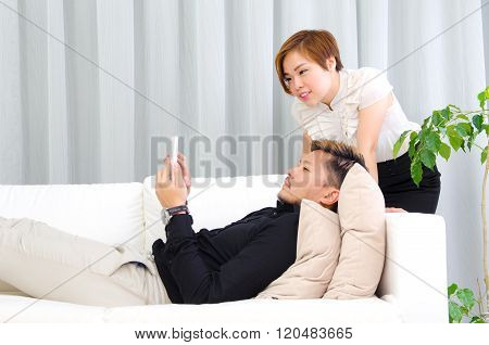 Asian Couple Relax At Home