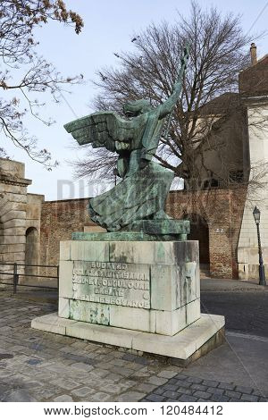 BUDAPEST, HUNGARY - FEBRUARY 02: Bronze statue of angel holding sword at Porta di Vienna, in the old town district. February 02, 2016 in Budapest.