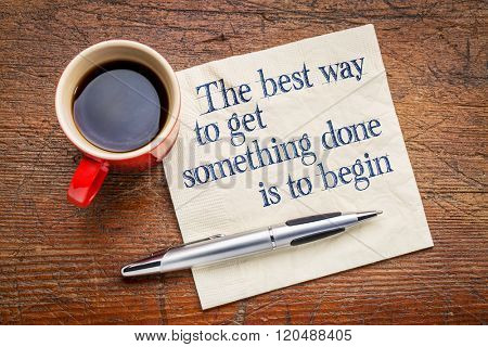the best way to get something done is to begin - inspirational phrase on a napkin with cup of coffee