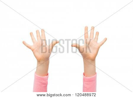 people, childhood, gesture and body parts concept - close up of little child hands raised up
