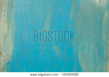 Blue background.Paint on metal surface