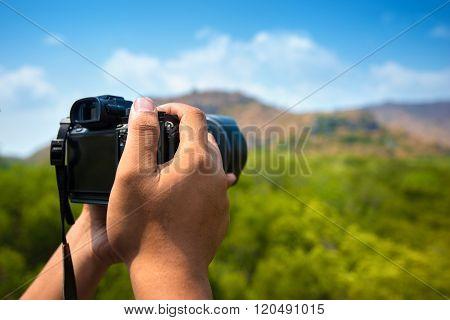 Man hand holding Camera