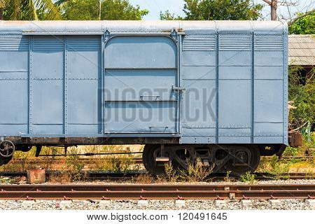 Close-up freight train bogie, transportation and heavy industry background.