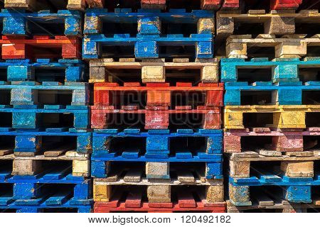Piles of colored wooden pallets, industry equipment