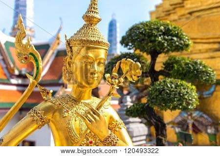Golden Angel (Ki-nara) with Pagoda Wat Pra Kaeo, Grand Palace, Bangkok ,Thailand.