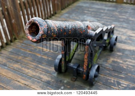Photo of an old cast iron cannon