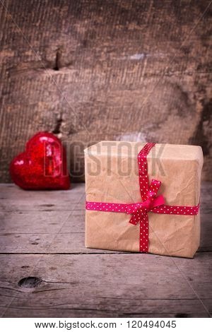 Gift Box  And Decorative Red  Heart On  Vintage  Wooden Background.