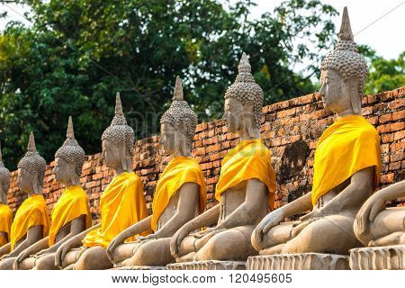 Aligned buddha statues at Wat Yai Chaimongkol Ayutthaya bangkok thailand.