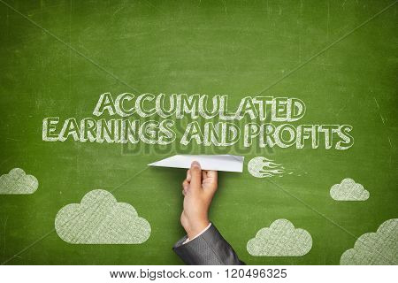 Accumulated earnings and profits concept on blackboard with paper plane