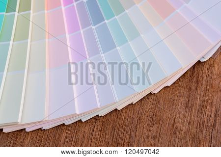 Color guide on wooden background for creative