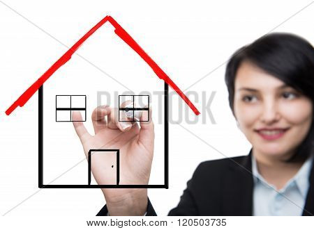 Business woman drawing house
