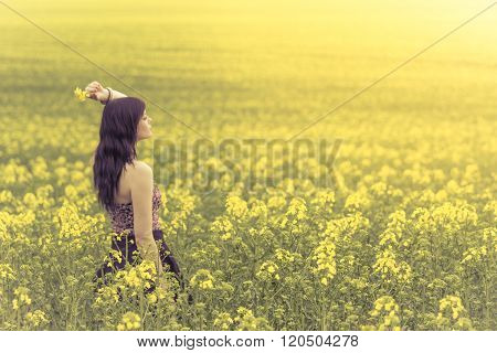 Beautiful Woman In Yellow Flowers From Side Behind Looking Right