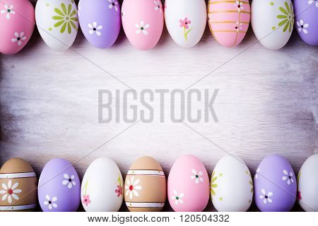 Pastel Colors Easter Eggs On A Grey Wooden Background.