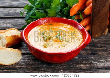 Carrot cream soup with vegetables and bread