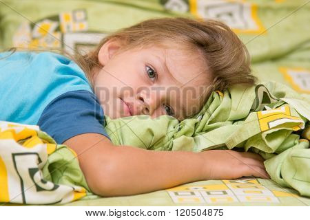Girl Lying On The Bed And Looking To The Right
