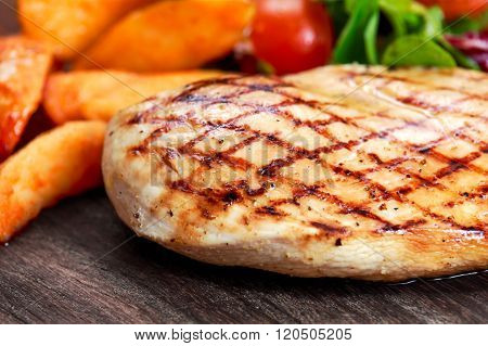 Grilled Chicken breast. with potato and vegetables