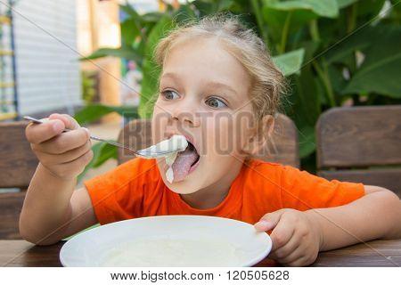 Five-year Girl Have Fun And Enjoy Eating Porridge For Breakfast