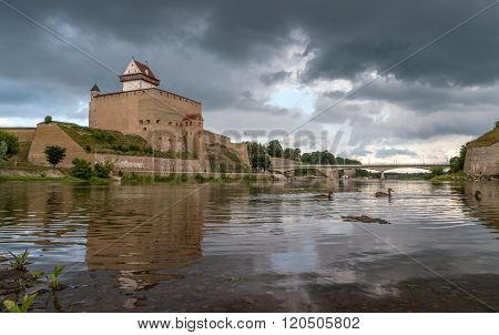 Narva Castle in Estonia on the background of a stormy sky.