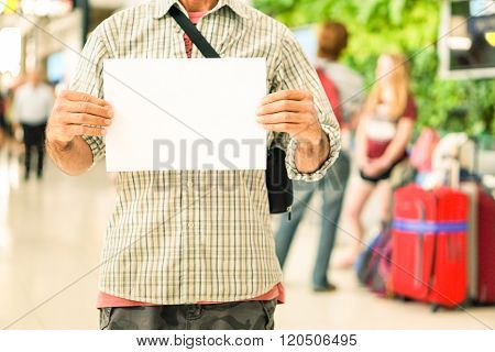 Man Hands Holding Empty Signboard At International Airport Meeting Point -