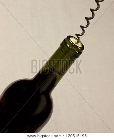 Bottle Of Red Wine With Corkscrew, With Copyspace