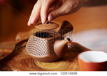 Close Up Table For Traditional Tea Ceremony Utensils, Chinese Teacup And Hand Of Tea Master Backgrou