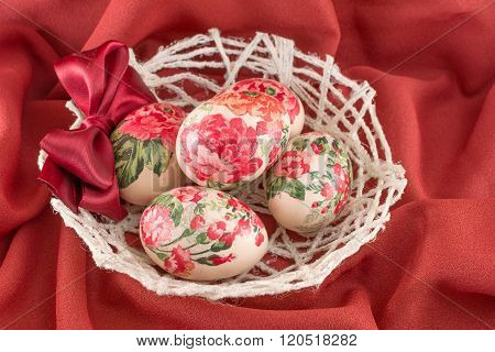 Colorful Decoupage Decorated Easter Eggs On Red Fabric