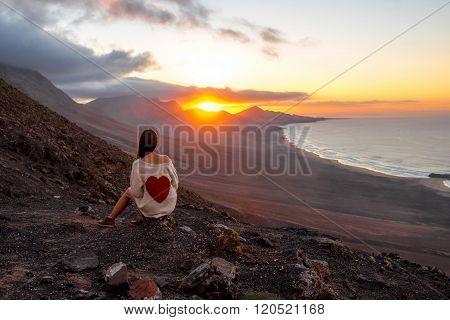 Woman enjoying beautiful landscape on Fuerteventura island