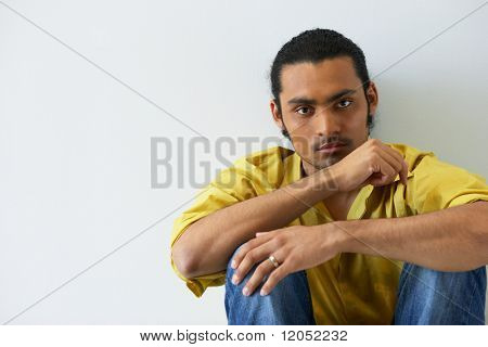 Portrait of man sitting on floor