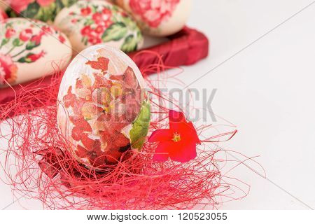 Decoupage Easter Egg On Red Straw