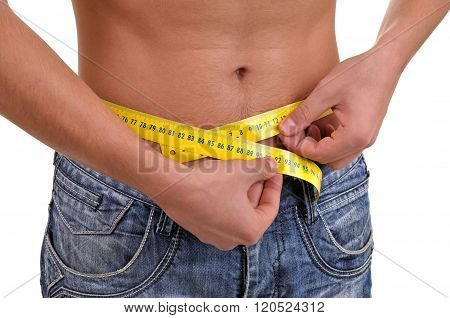 Close Up With A Waist And Metter. Slim Fit Concept. Young Fitness Man Measuring His Waist